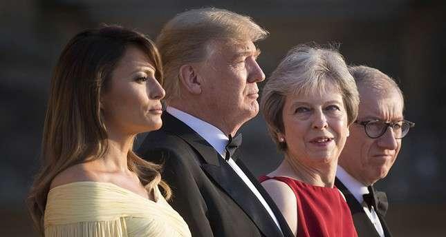 Trump és May a házastársaikkal